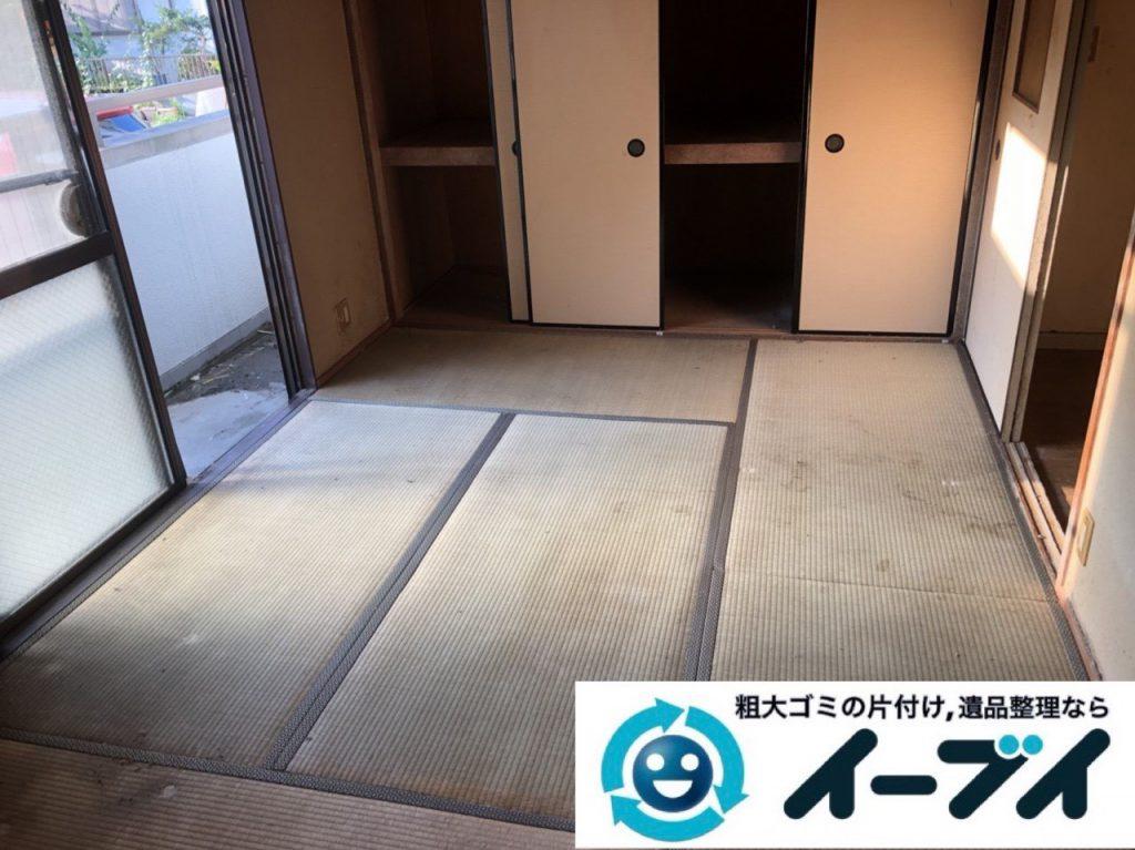 2019年1月6日大阪府大阪市大正区でコタツや生活用品に溢れた部屋の片付け作業。写真2