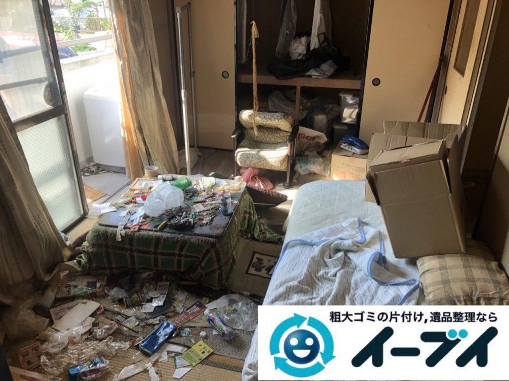 2019年1月6日大阪府大阪市大正区でコタツや生活用品に溢れた部屋の片付け作業。写真1