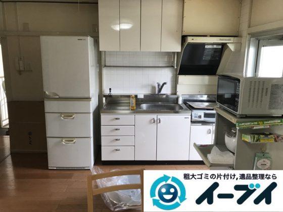2019年4月7日大阪府大阪市淀川区で台所や収納棚の不用品回収作業。写真1