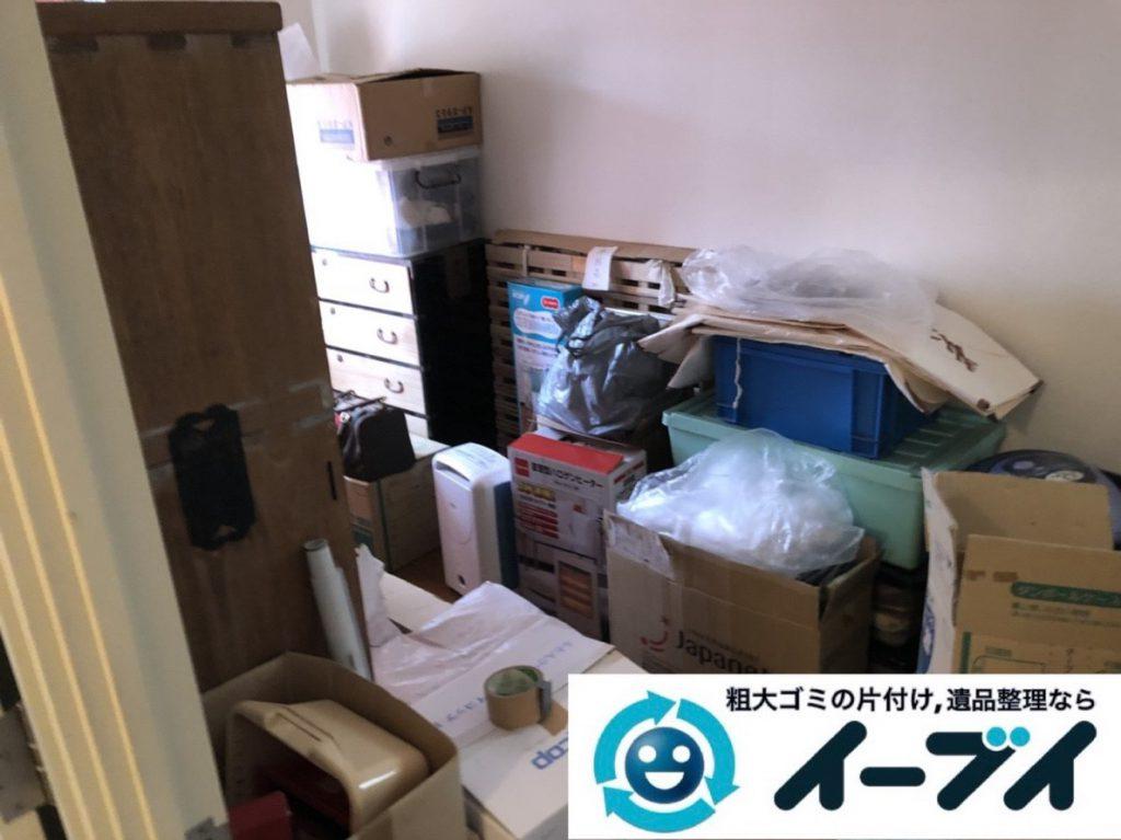 2019年3月23日大阪府大阪市鶴見区で家財道具が散乱したお部屋の片付け作業。写真1