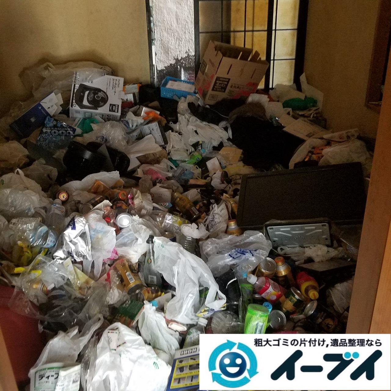 2019年9月11日大阪府大阪市福島区で食品ゴミや生活ゴミが散乱したゴミ屋敷の片付け作業。写真5